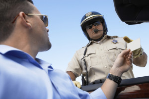Handing driver license to officer