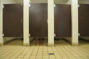 Restroom-stalls-with-feet-300x199