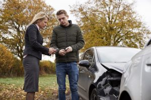Drivers-exchanging-info-after-accident-300x200