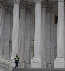 Officer-on-steps-of-DC-building-1-275x300
